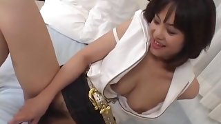 Mako Takeda spreads legs for clog to rub her hairy twat